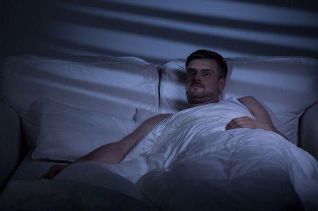 man-awake-in-bed