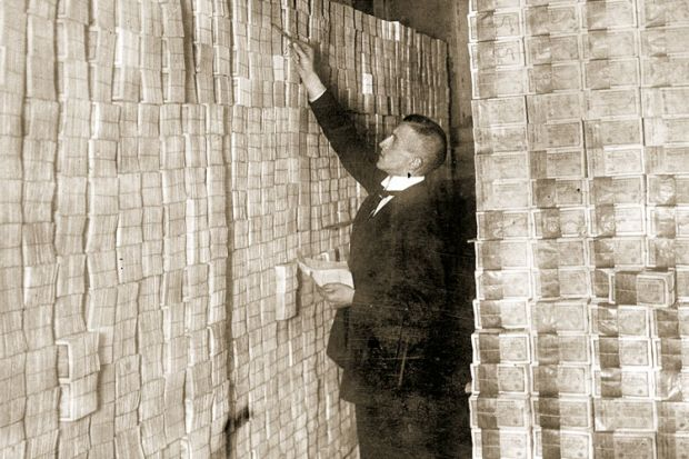 Man counting banknotes, Weimar Republic, Germany, 1923