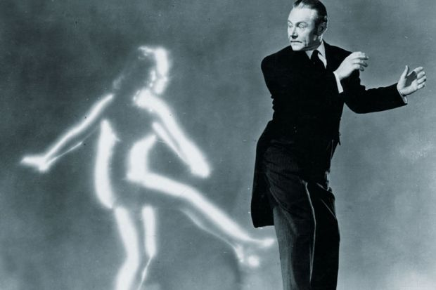 Man dancing with ghost of woman