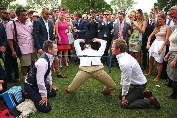 Man doing limbo under ties