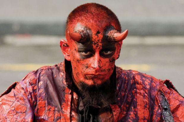 Man dressed as the devil/satan