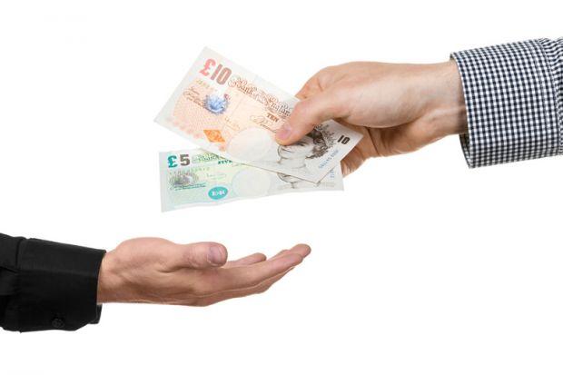 Man handing over British bank notes