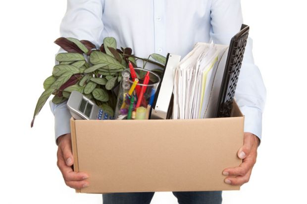 Man holding a box filled with work-related items