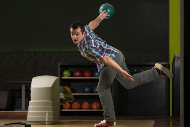 Man in dramatic bowling pose