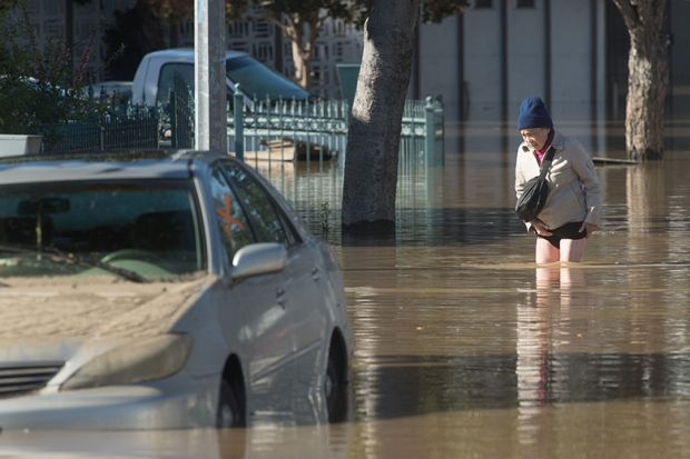 man in flood waters California