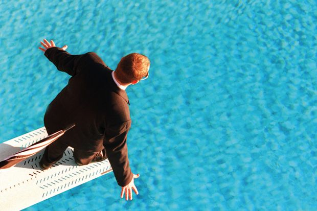 Man in suit on diving board