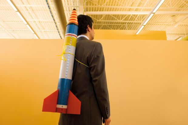 Man in suit with rocket strapped to back