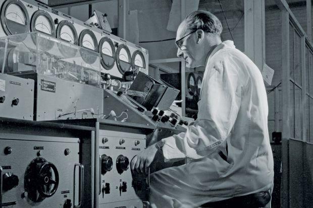 Man inspecting Keystrian magnetious valves at Mullard