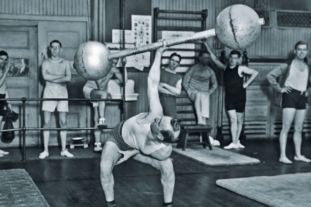 Man lifting barbell one-handed