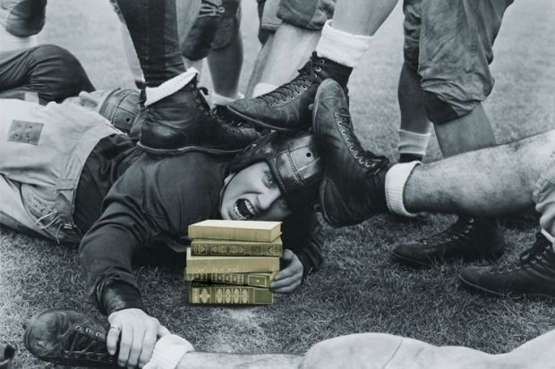 Man lying beneath rugby pile-up
