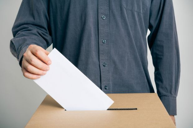 Man putting vote in ballot box