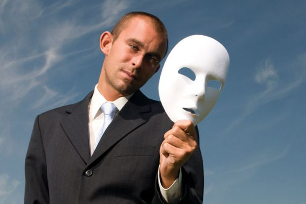 Businessman holding white face mask