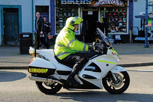 Man riding medical blood motorbike