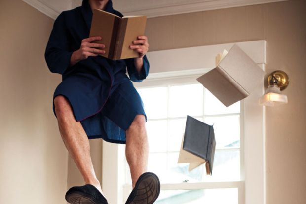 Man sitting and reading in mid air