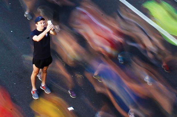 Man takes picture, City2Surf fun run, Sydney, Australia, 2013