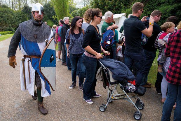 Man taking part in battle reenactment, Arundel Castle, England