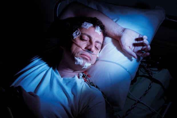 Man undergoing polysomnographic examination