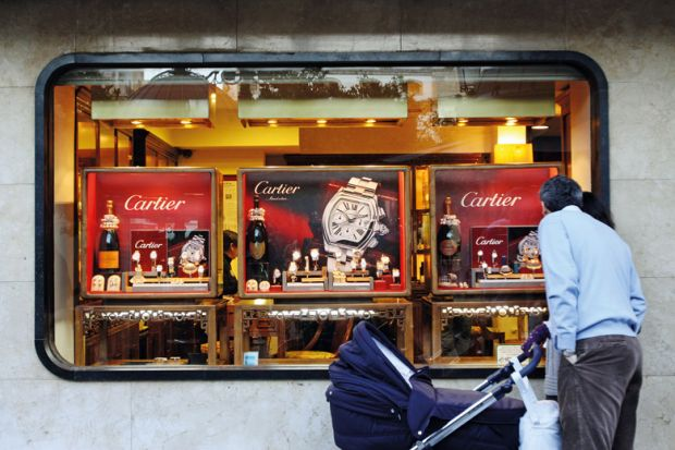 Man window shopping for Cartier watches, Córdoba, Spain