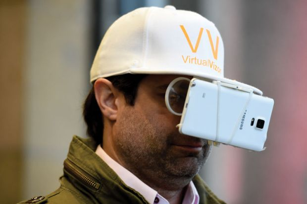 Man with smartphone strapped to baseball cap
