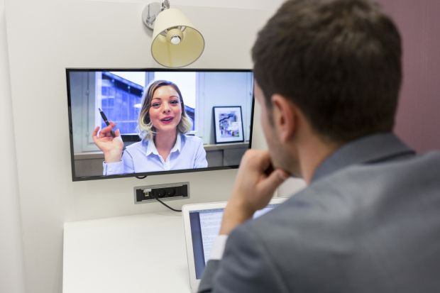 Man and woman videoconferencing