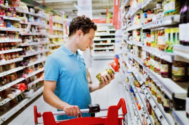 Man choosing in supermarket
