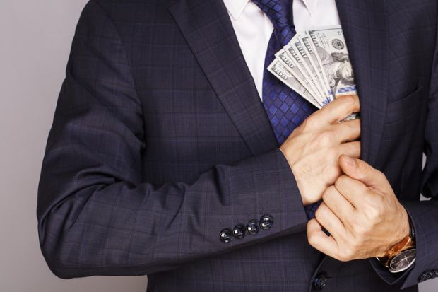 Man puts money in jacket