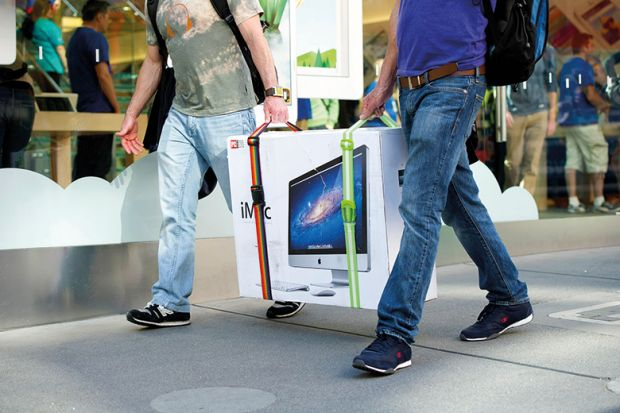 Two men carrying a TV