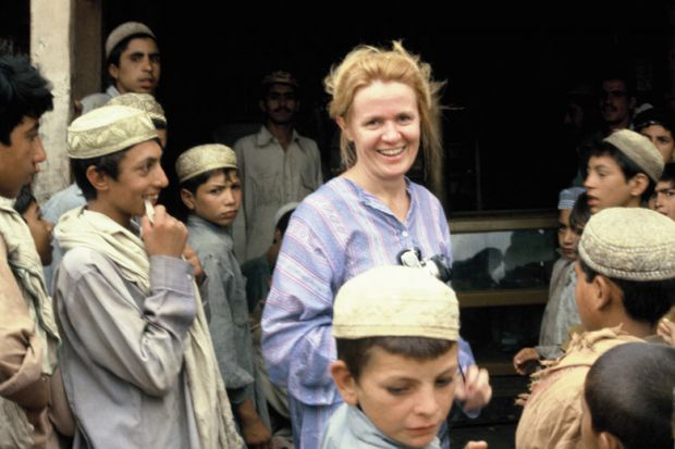 Mary Guinan with group of young children