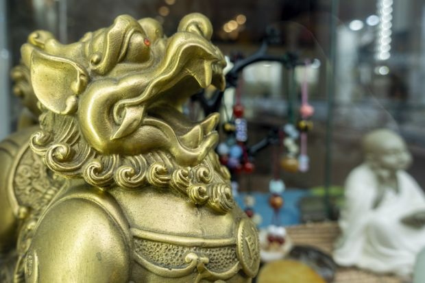 Melbourne, Australia - May 12, 2019 Chinese lion figurine. Chinatown shop along Little Bourke Street in the Central Business District (CBD) that sells oriental souvenirs.