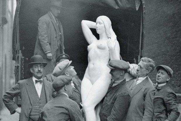 men-carrying-female-statue