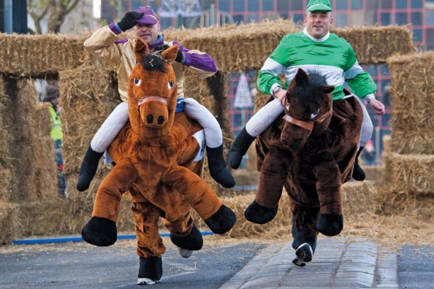 Men competing in pantomime horse race, Birmingham