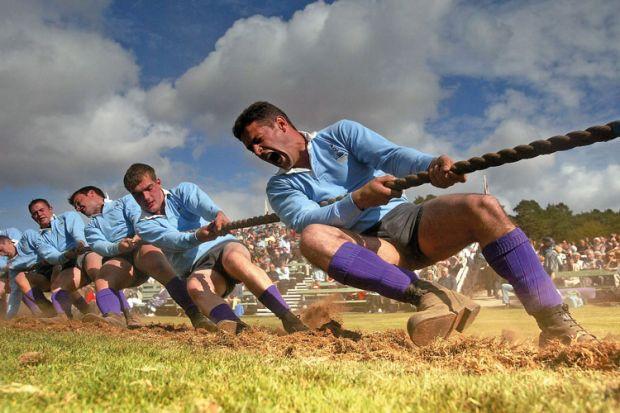 Men competing in tug of war