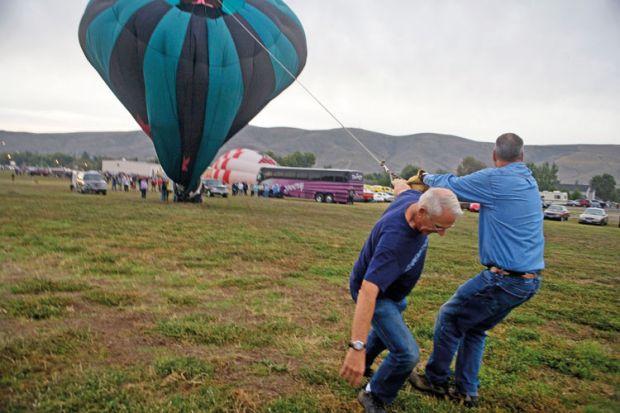Men deflating hot air balloon, Great Prosser Balloon Rally