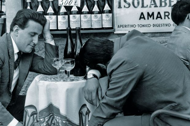 Men slumped at table