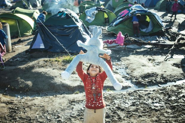Child playing in refugee camp
