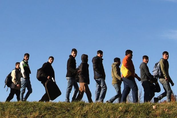 Migrants walking to registration point, Germany