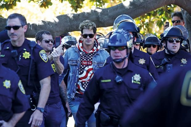 Milo Yiannopoulus surrounded by police
