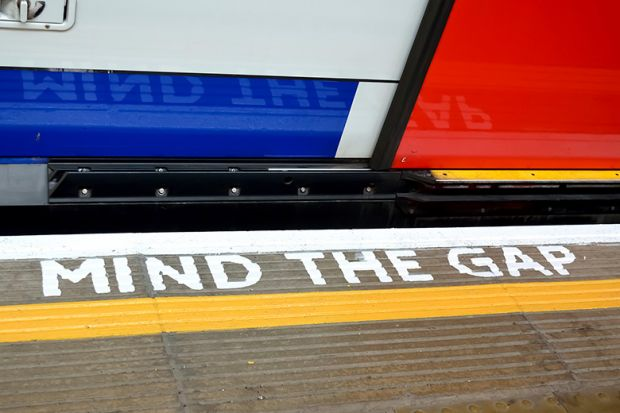 'Mind the Gap' sign painted on London Underground floor