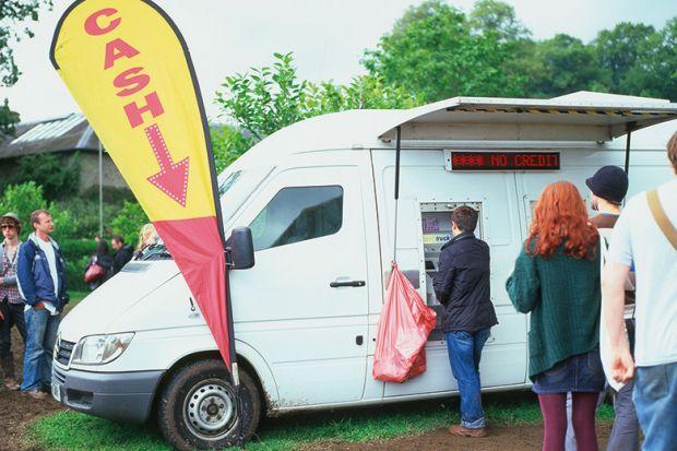 Mobile cash machine white van at the Green Man Festival Wales UK