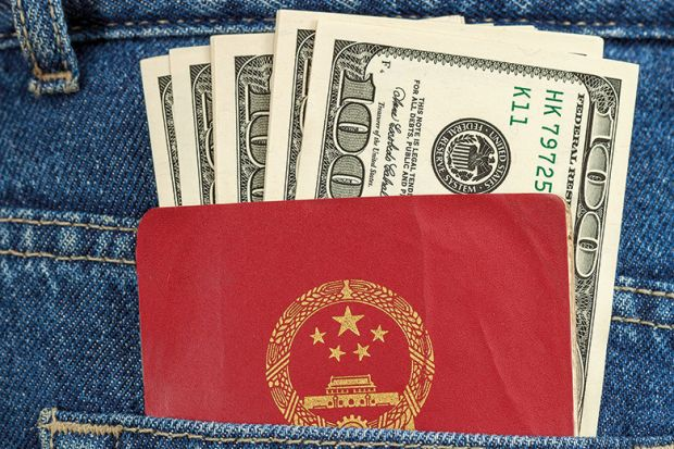 Money and passport in back pocket