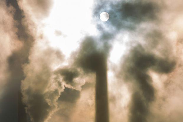 Moonlit sky behind clouds of smoke