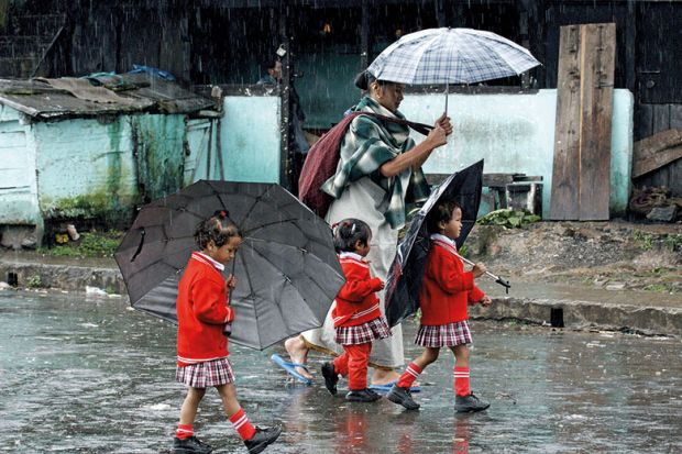 mother and daughters in rain