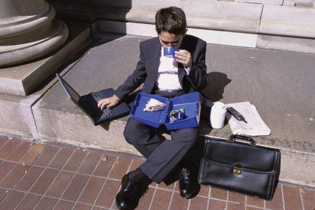 Man multitasking work