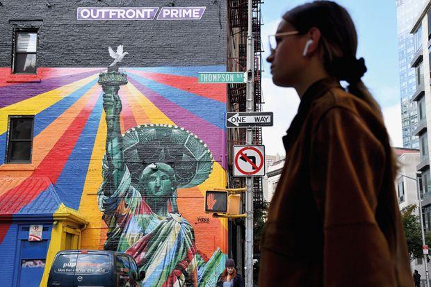 Woman walking past a mural