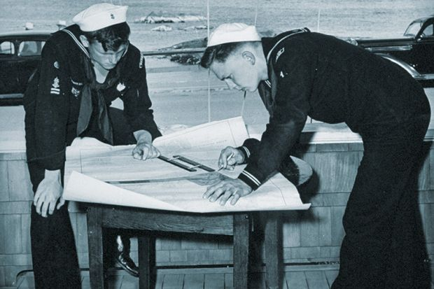 Naval officers with chart