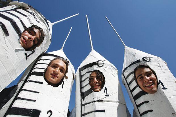 People dressed in syringe costumes