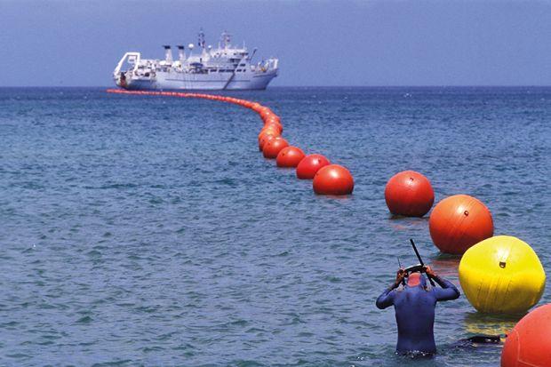 Buoys and ship at sea