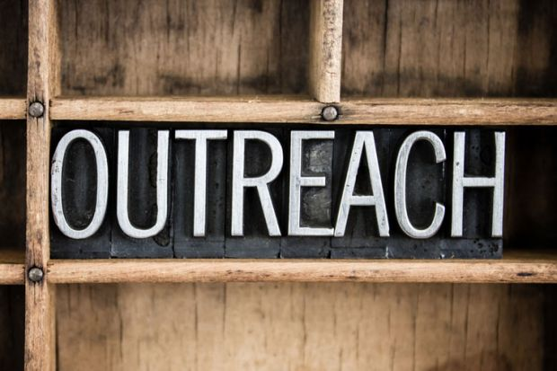 Outreach sign carved in wood