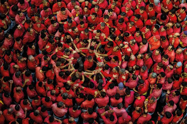 Crowd of people dressed in red