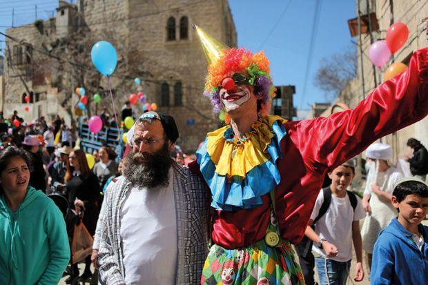 Jewish people celebrate festival of Purim in Hebron, West Bank